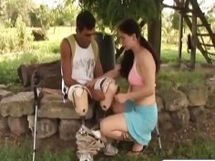 Chick gives head to amputee and rides cock outdoors