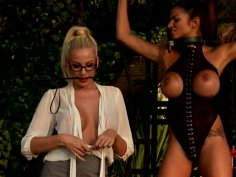 Blonde dominatrix plays with her doll