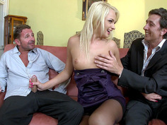 Ivana Sugar grabs two cocks and starts sucking both of them