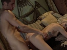 Tattooed blonde babe Monique Alexander getting laid on the sofa