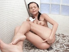 Teen fingers vagina doggy style in a softcore act